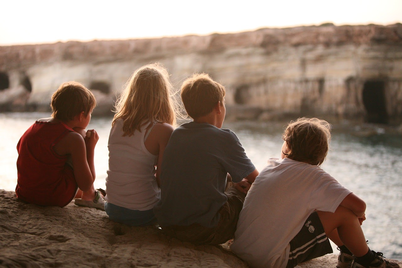 group of children by the sea