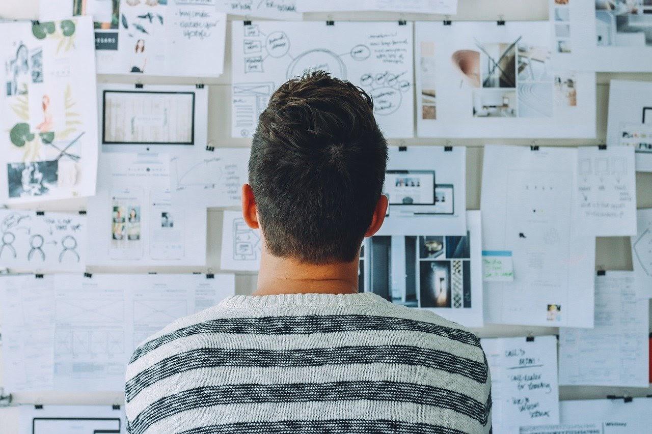 man analysing data on wall