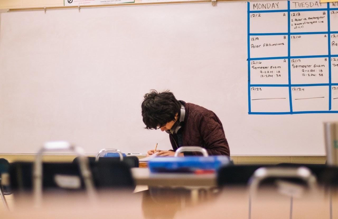 young man taking exam