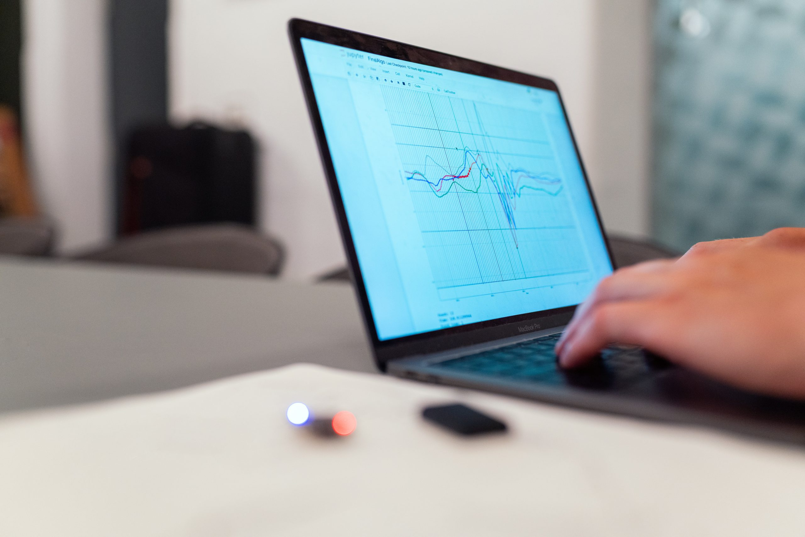 person analysing graph on laptop