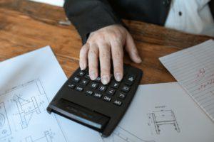 hand over black calculator