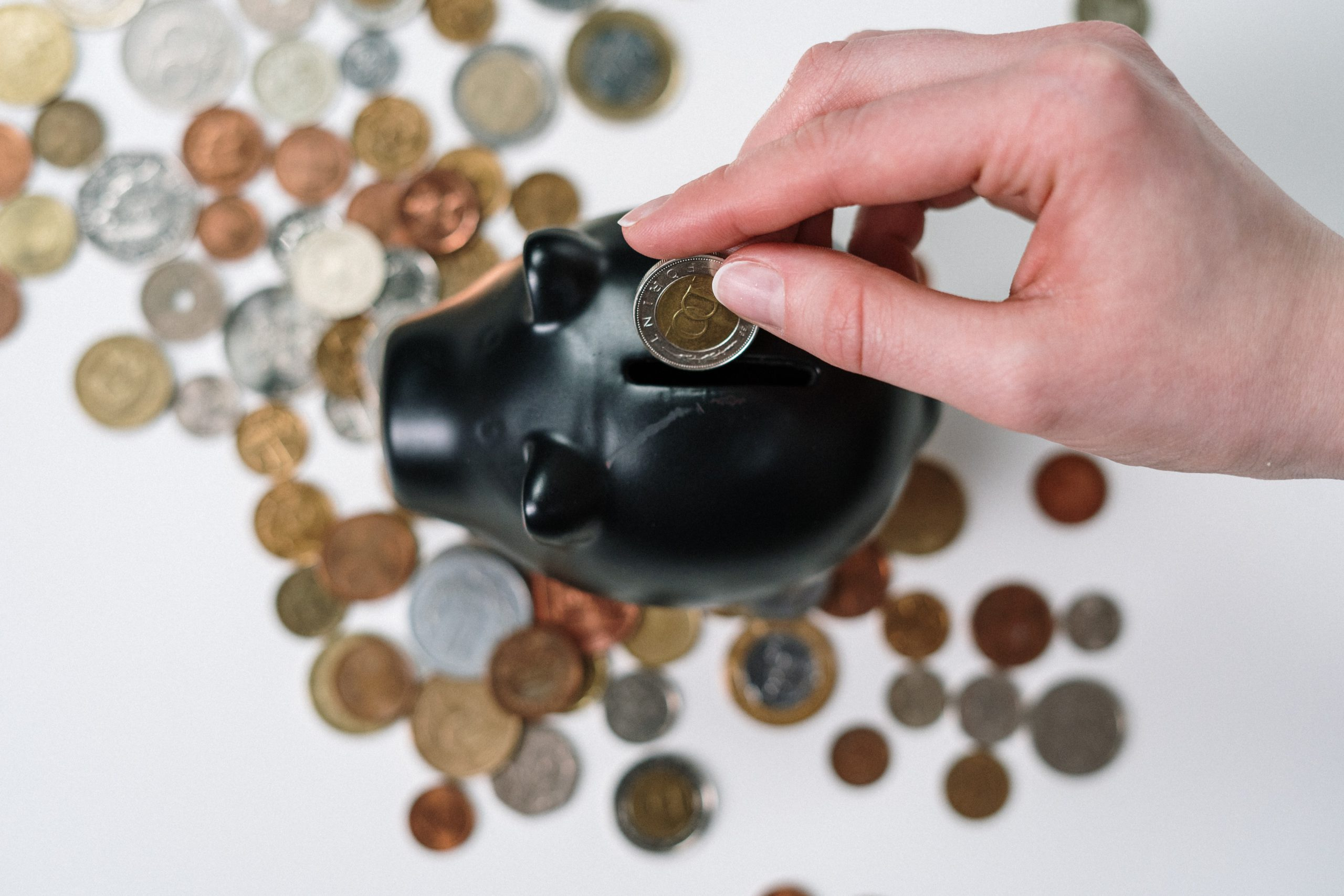 piggy bank with person saving money