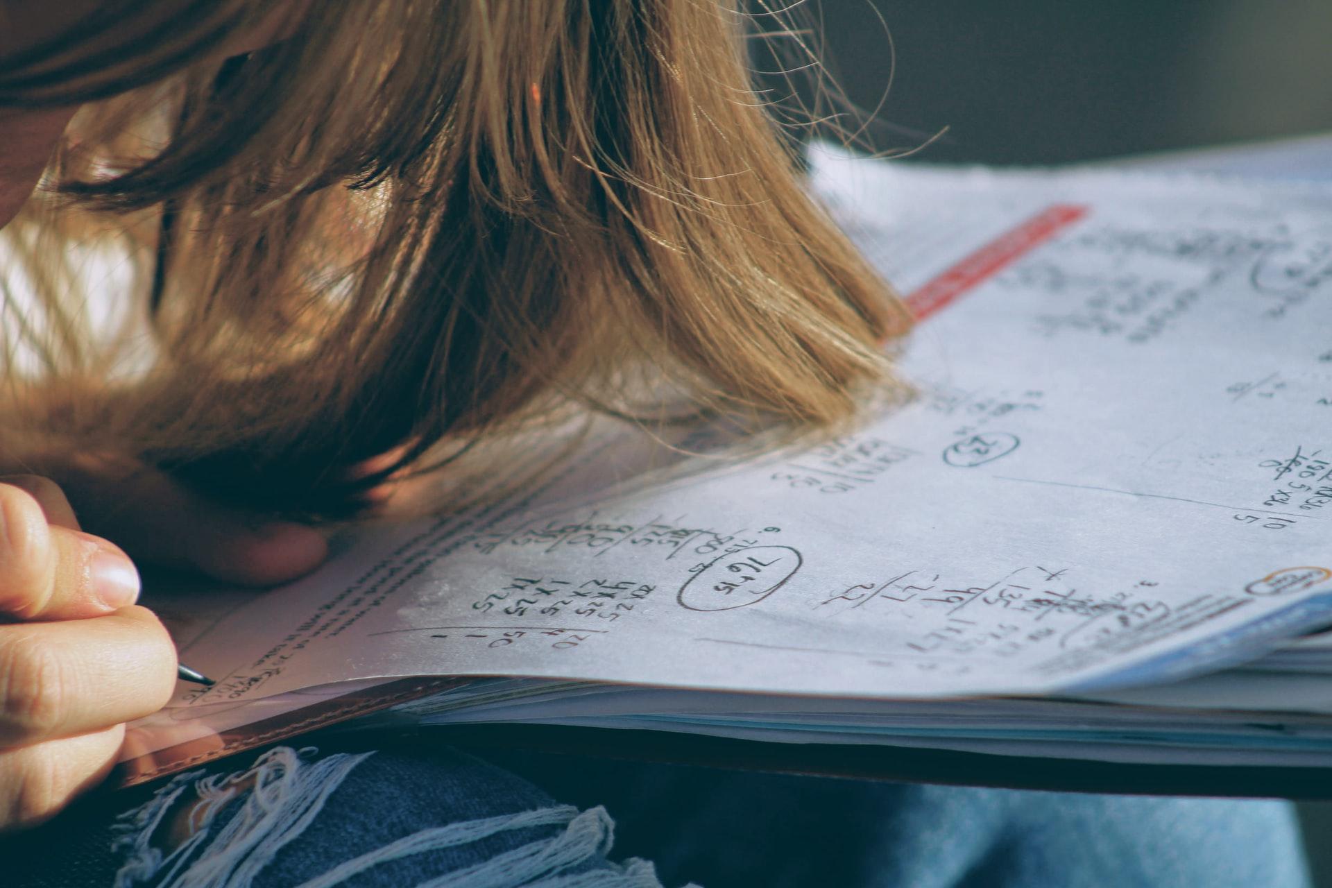 girl doing maths sums